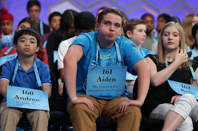 <p>Aiden Jeffrey Arnett (C) of Morgantown, West Virginia, waits on stage during round two of 2017 Scripps National Spelling Bee at Gaylord National Resort & Convention Center May 31, 2017 in National Harbor, Maryland. Close to 300 spellers are competing in the annual spelling contest for the top honor this year. (Alex Wong/Getty Images) </p>