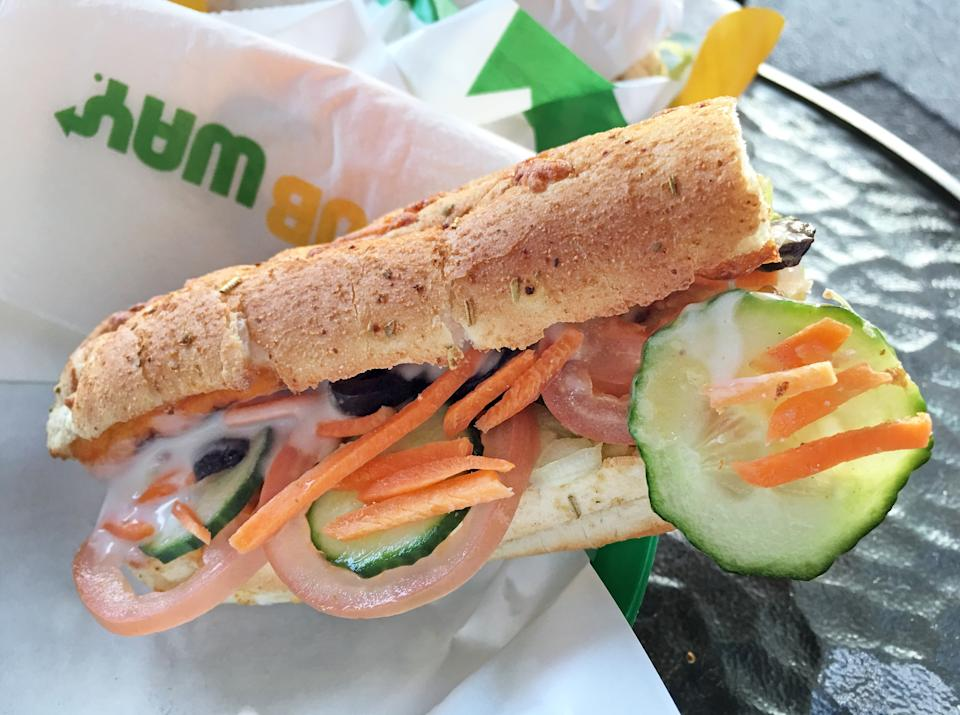 SUBWAY sandwich on a table. It's the largest single-brand restaurant chain in the world with 43,035 restaurants in 108 countries