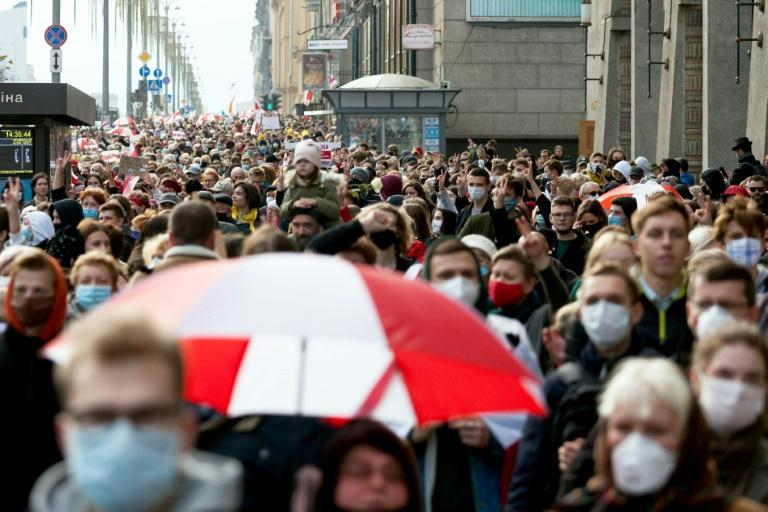 People parade through the streets of Minsk in support of a nationwide strike seeking the resignation of Belarus President Alexander Lukashenko