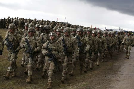 U.S. soldiers attend welcoming ceremony for U.S.-led NATO troops at polygon near Orzysz