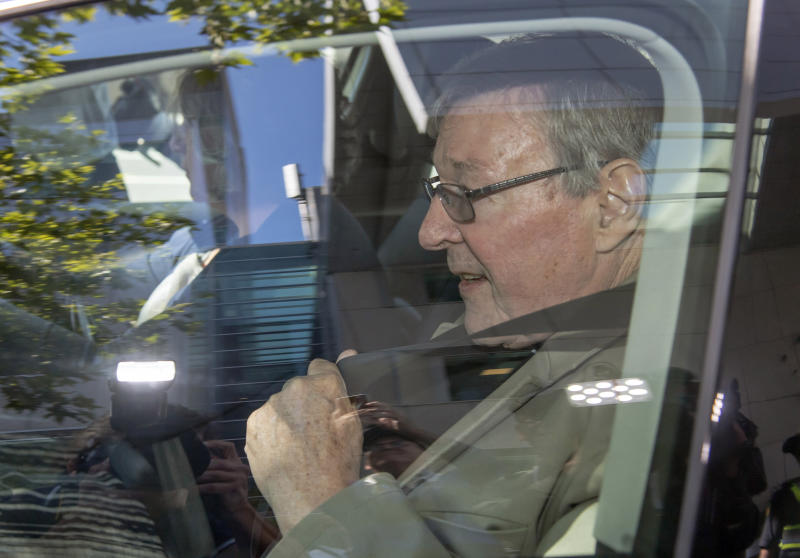 In this Friday, Feb. 22, 2019, photo, Cardinal George Pell leaves the County Court in Melbourne, Australia. The most senior Catholic cleric ever charged with child sex abuse has been convicted Tuesday, Feb. 26, 2019 of molesting two choirboys moments after celebrating Mass, dealing a new blow to the Catholic hierarchy's credibility after a year of global revelations of abuse and cover-up. (AP Photo/Andy Brownbill)