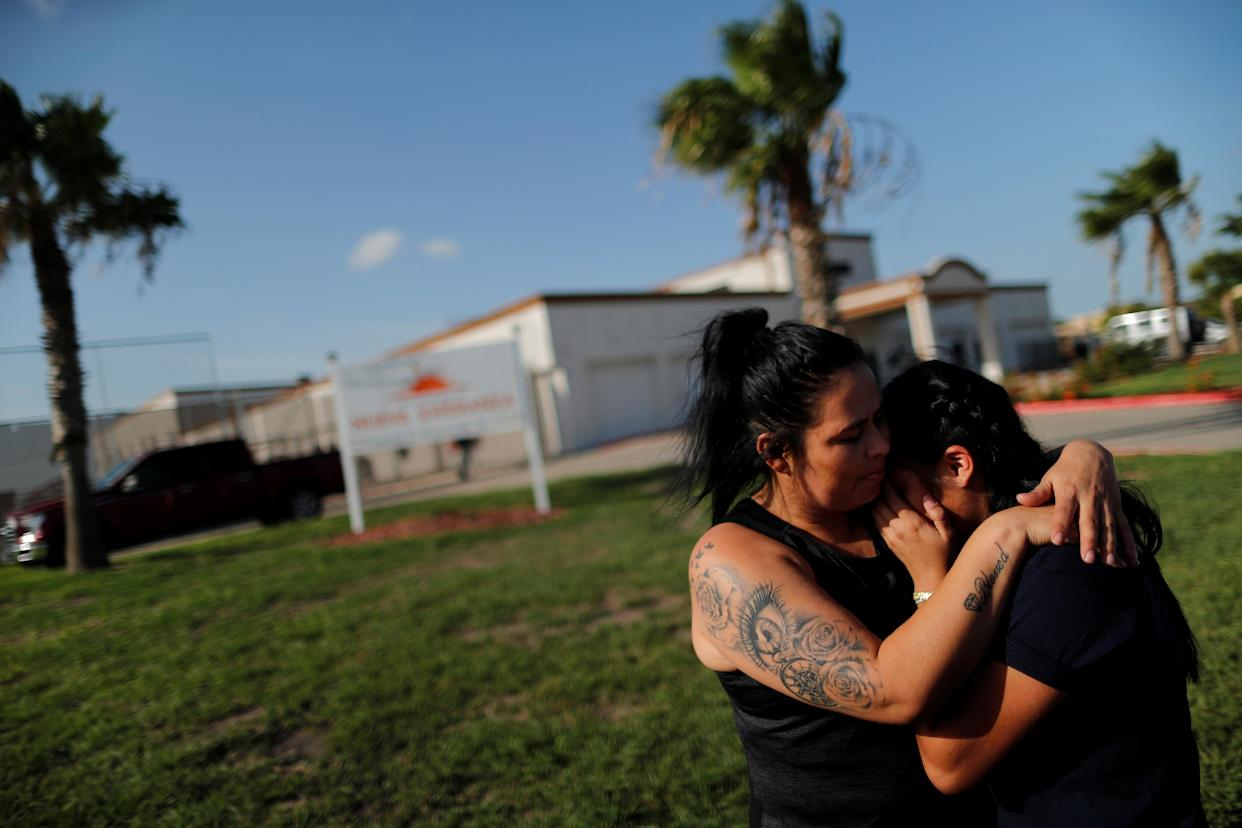 """<span class=""""s1"""">Isabela, an asylum seeker from El Salvador, hugs her 17-year-old daughter, Dayana, on July 11 outside the federally contracted shelter Casa Esperanza in Brownsville, Texas. They had been separated earlier at the U.S.-Mexico border. (Photo: Carlos Barri/Reuters)</span>"""