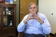 FILE - In this Sept. 7, 2018, file photo, Sen Jeff Merkley, D-Ore., sits for an interview in his office in Portland, Ore. National lawmakers, including Merkley, are expected on Wednesday, Dec. 2, 2020, to introduce a joint resolution aimed at striking language from the U.S. Constitution that enshrines a form of slavery in America's foundational documents. (AP Photo/Andrew Selskey, File)