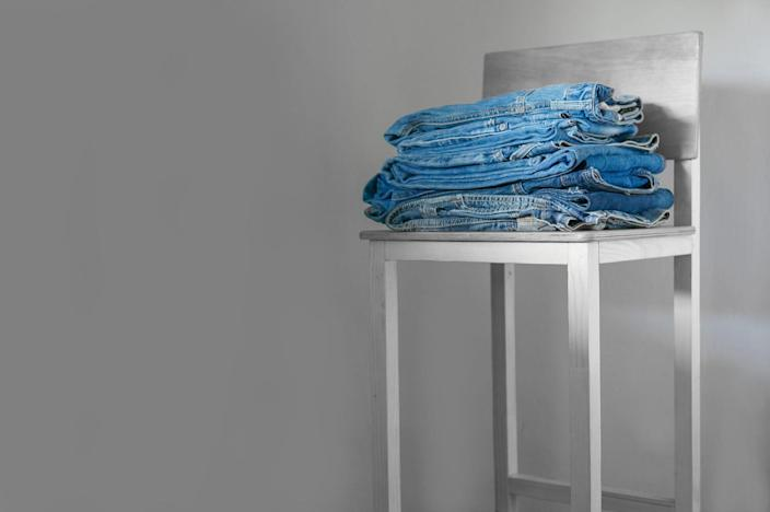 Pile of Jeans on Chair