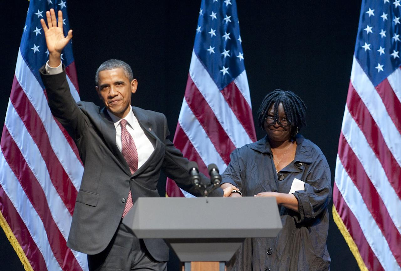 "<p>Obama holds Goldberg's hand as he waves to the crowd at a special 2011 fundraising performance of the Broadway musical <a rel=""nofollow"" href=""http://www.broadway.com/shows/sister-act/""><em>Sister Act</em></a> in New York on behalf of the Democratic National Committee.</p>"