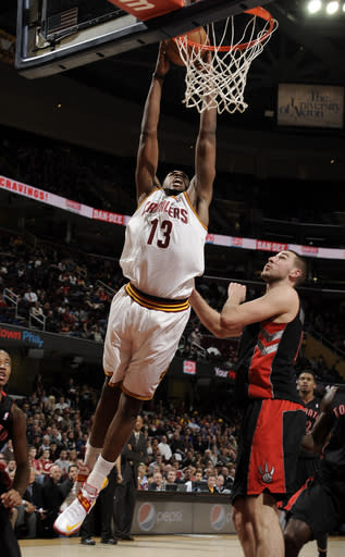 CLEVELAND, OH - FEBRUARY 27: Tristan Thompson #13 of the Cleveland Cavaliers goes up for the dunk against Jonas Valanciunas #17 of the Toronto Raptors at The Quicken Loans Arena on February 27, 2013 in Cleveland, Ohio. (Photo by David Liam Kyle/NBAE via Getty Images)
