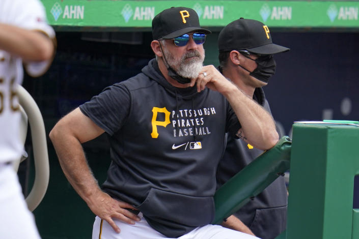 Pittsburgh Pirates manager Derek Shelton stands on the top of the dugout steps during a baseball game against the Los Angeles Dodgers in Pittsburgh, Thursday, June 10, 2021. (AP Photo/Gene J. Puskar)