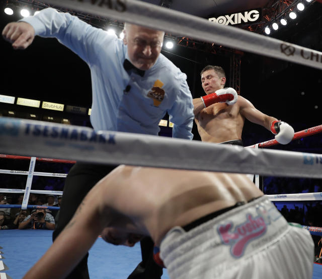 Gennady Golovkin reacts after knocking down Vanes Martirosyan during their middleweight title boxing match Saturday, May 5, 2018, in Carson, Calif. Golovkin won the bout. (AP Photo/Chris Carlson)