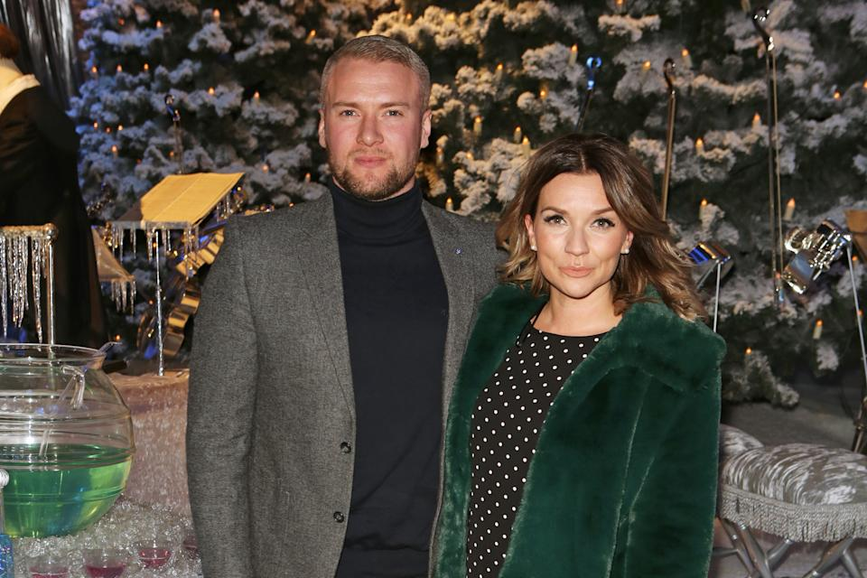 "WATFORD, ENGLAND - NOVEMBER 22:  Liam Macaulay (L) and Candice Brown attend the VIP launch of ""Hogwarts In The Snow"" at Warner Bros. Studio Tour London: The Making Of Harry Potter on November 22, 2017 in Watford, England.  (Photo by David M. Benett/Dave Benett/Getty Images for Warner Bros. Studio Tour)"