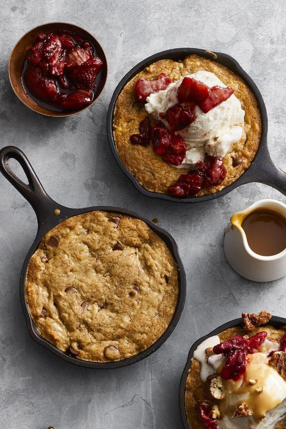 "<p>Turn the dessert course into an interactive experience — complete with a customizable skillet cookie station! — and the chances of your guest crashing on your couch (hello, turkey coma) will dramatically decrease. </p><p><em><a href=""https://www.goodhousekeeping.com/food-recipes/dessert/a47671/skillet-cookie-sundaes-recipe/"" rel=""nofollow noopener"" target=""_blank"" data-ylk=""slk:Get the recipe for Skillet Cookie Sundaes »"" class=""link rapid-noclick-resp"">Get the recipe for Skillet Cookie Sundaes »</a></em></p>"