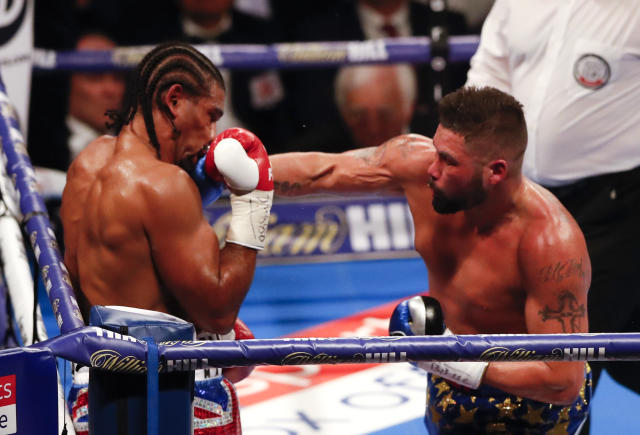 Britain's Tony Bellew, right, sends a left, to his countryman David Haye during the boxing heavyweight rematch bout between Tony Bellew and David Haye at the O2 Arena in London, Saturday, May 5, 2018. (AP Photo/Frank Augstein)