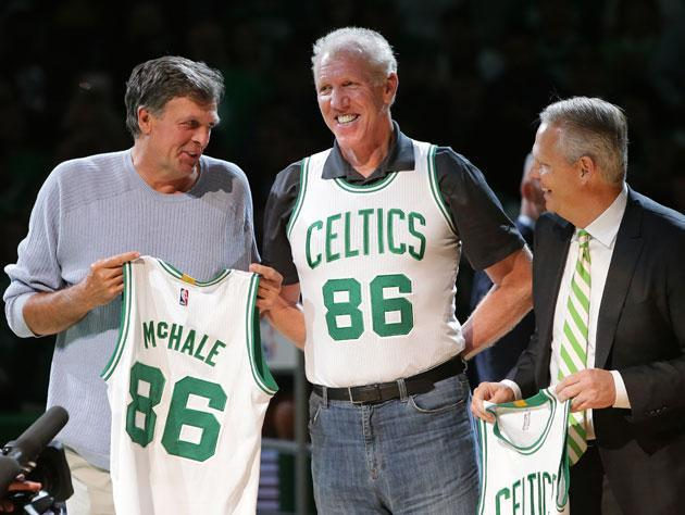 Danny Ainge happily welcomes Kevin McHale and Bill Walton's belt back to Boston. (Getty Images)