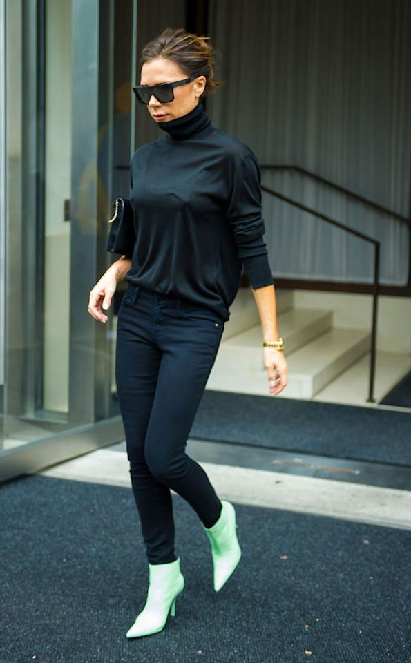 <p>Victoria Beckham was photographed in Madison Square Park in New York donning all-black with a pop of colour (courtesy of some seriously-covetable boots). [Photo: Getty] </p>