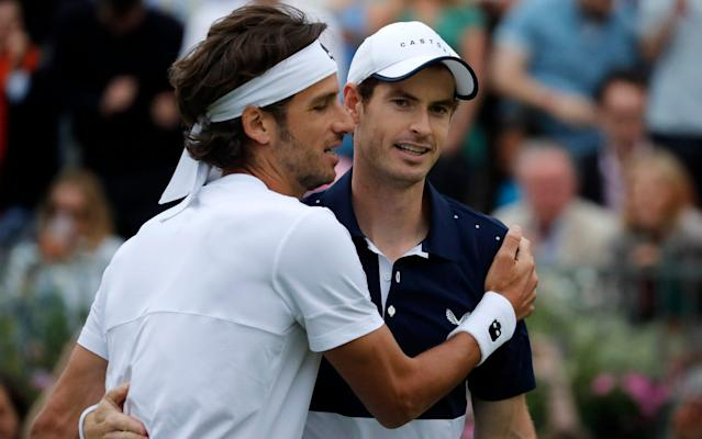 Andy Murray and Feliciano Lopez produced a stunning win over the top seeds Juan Sebastian Cabal and Robert Farah - AP