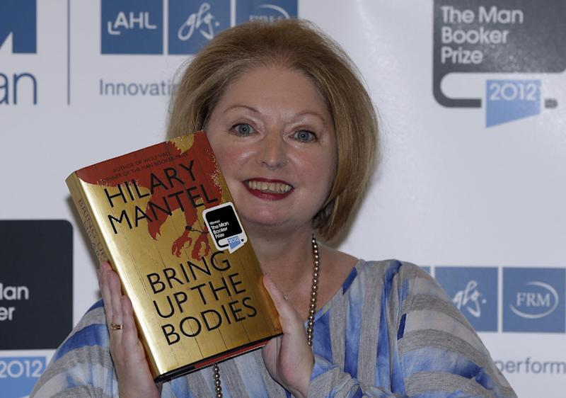 Hilary Mantel, winner of the Man Booker Prize for Fiction, poses for the photographers with a copy of her book 'Bring up the Bodies', shortly after the award ceremony in central London, Tuesday, Oct. 16, 2012. Mantel, won the 50,000 British pounds (80,000 US dollars) prize. (AP Photo/Lefteris Pitarakis)