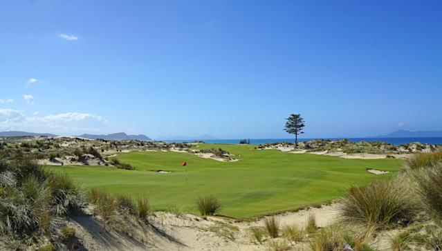 """<div class=""""caption""""> A view of the 18th hole from behind its green </div>"""