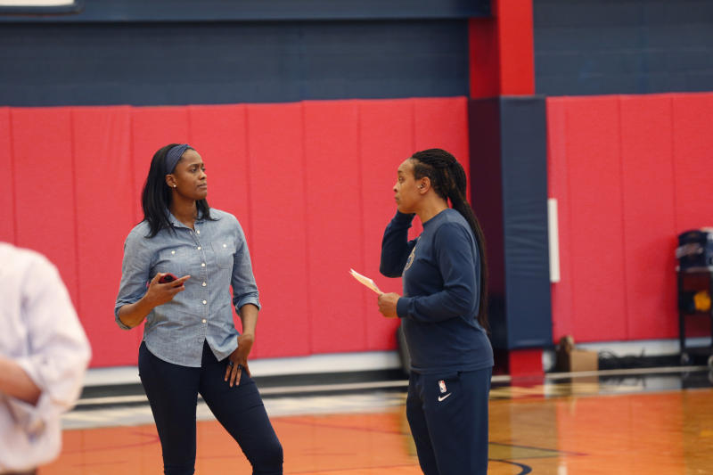New Orleans Pelicans vice president of basketball operations Swin Cash, left, talks with two-way player development coach Teresa Weatherspoon at their NBA basketball training facility in Metairie, La., Wednesday, Jan. 15, 2020. (AP Photo/Gerald Herbert)