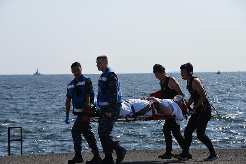 Several US crew members were injured and had to be evacuated by air to hospital (AFP Photo/STR)