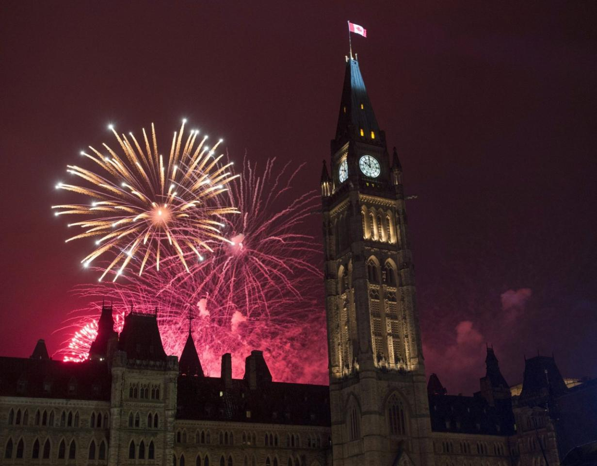 Fireworks light up the sky red behind the Peace Tower during Canada Day celebrations on Parliament Hill on Friday, July 1, 2016 in Ottawa. Canada has ranked as the second most socially progressive country according to a new study.  THE CANADIAN PRESS/Justin Tang