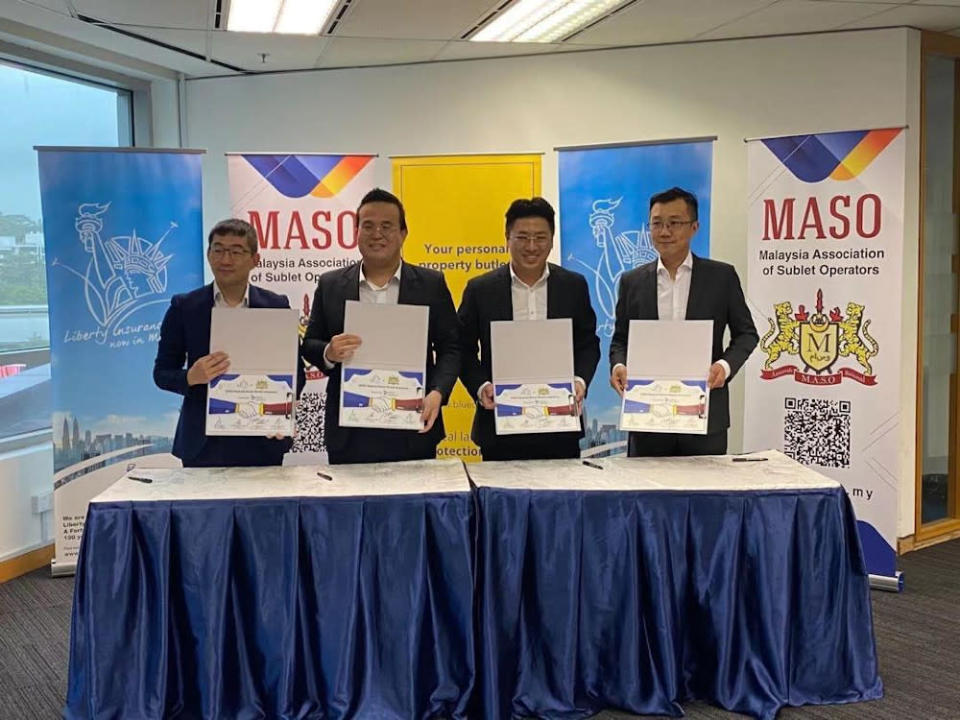 (From left) Maso vice president Eric Yap, Maso president Ken Lee, BlueDuck founder Earnest Wong, and Liberty Insurance head of commercial lines Foo Yong Chiat announce their partnership at an official ceremony. — Picture courtesy of BlueDuck