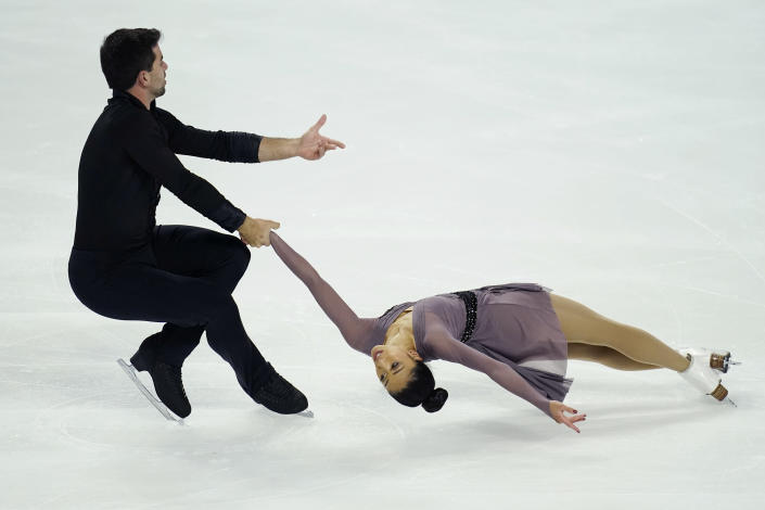 Jessica Calalang, right, and Brian Johnson perform during the pairs short program at the U.S. Figure Skating Championships, Thursday, Jan. 14, 2021, in Las Vegas. (AP Photo/John Locher)