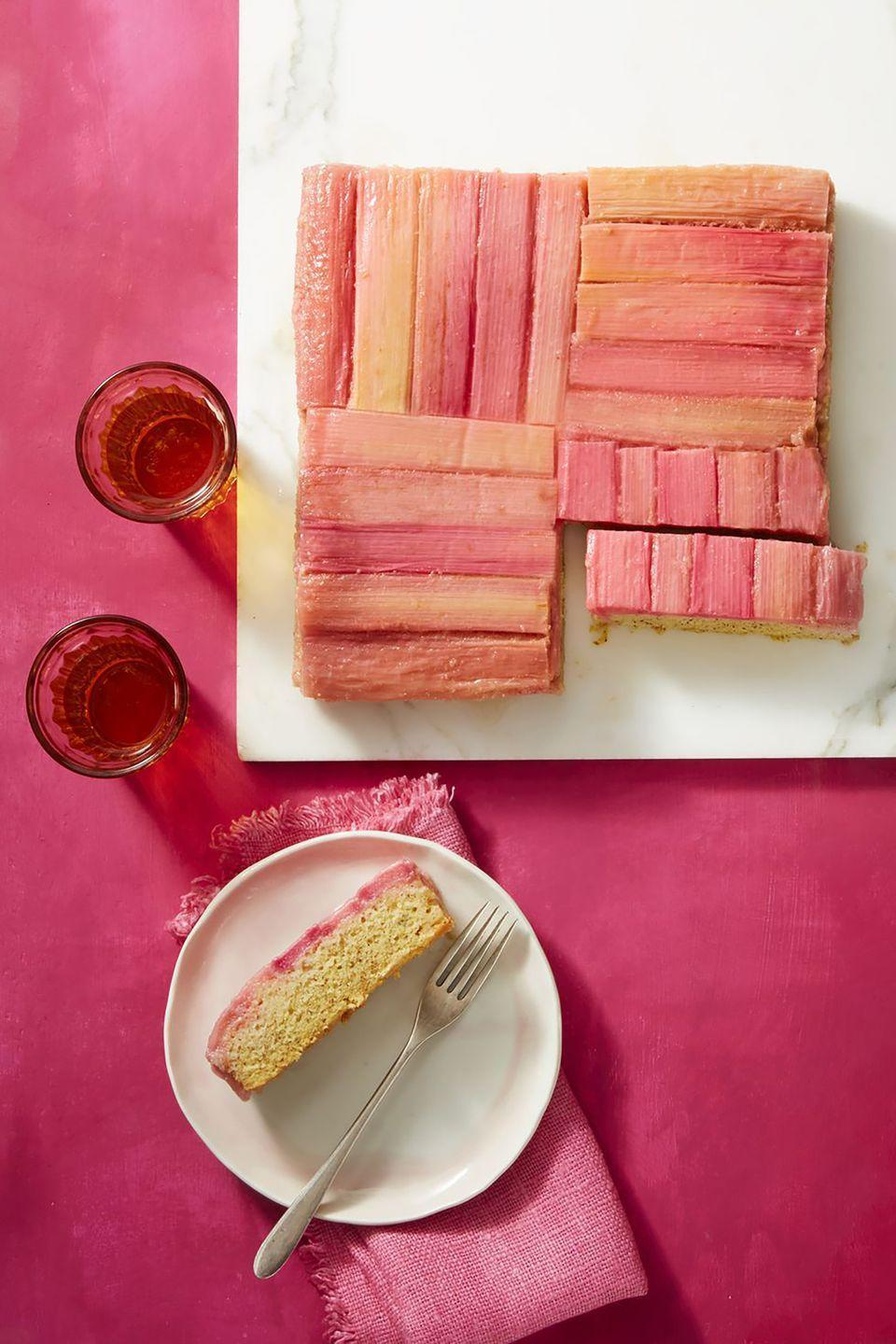 """<p>Made with rhubarb and orange juice, this pretty pink cake is the perfect dessert for spring. </p><p><a href=""""https://www.womansday.com/food-recipes/food-drinks/a19810598/rhubarb-and-almond-upside-down-cake-recipe/"""" rel=""""nofollow noopener"""" target=""""_blank"""" data-ylk=""""slk:Get the recipe for Rhubarb and Almond Upside-Down Cake."""" class=""""link rapid-noclick-resp""""><em>Get the recipe for Rhubarb and Almond Upside-Down Cake.</em></a> </p>"""