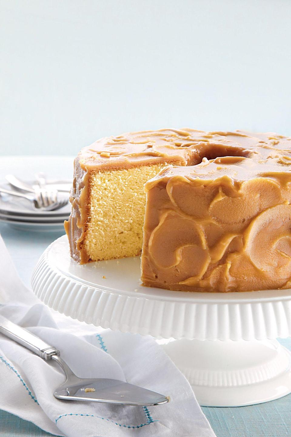 """<p><strong>Recipe: <a href=""""https://www.southernliving.com/recipes/caramel-frosted-pound-cake"""" rel=""""nofollow noopener"""" target=""""_blank"""" data-ylk=""""slk:Caramel-Frosted Pound Cake"""" class=""""link rapid-noclick-resp"""">Caramel-Frosted Pound Cake</a></strong></p> <p>This cake is a a surefire crowd-pleaser. Before serving, use an offset spatula to create a frosted swirl effect. </p>"""