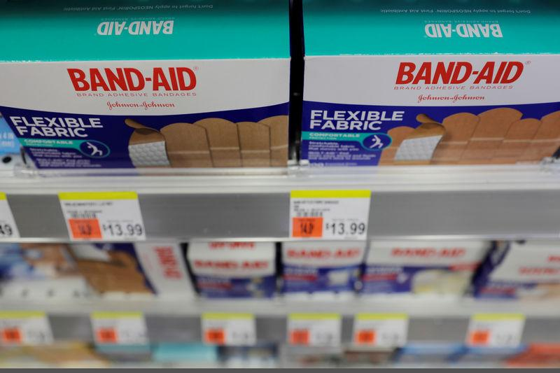 FILE PHOTO: Johnson & Johnson products stand on a shelf in a store in New York