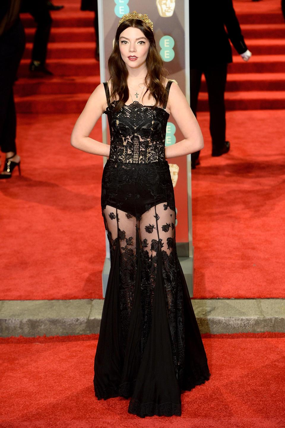 <p>Anya wore black in solidarity with the Time's Up movement with this sheer Dolce &amp; Gabbana gown.</p>