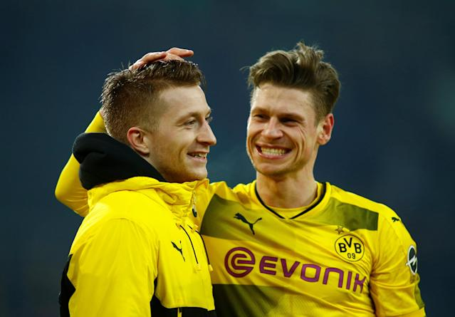 Soccer Football - Bundesliga - Borussia Moenchengladbach vs Borussia Dortmund - Borussia-Park, Moenchengladbach, Germany - February 18, 2018 Borussia Dortmund's Marco Reus celebrates after the match with Lukasz Piszczek REUTERS/Thilo Schmuelgen DFL RULES TO LIMIT THE ONLINE USAGE DURING MATCH TIME TO 15 PICTURES PER GAME. IMAGE SEQUENCES TO SIMULATE VIDEO IS NOT ALLOWED AT ANY TIME. FOR FURTHER QUERIES PLEASE CONTACT DFL DIRECTLY AT + 49 69 650050