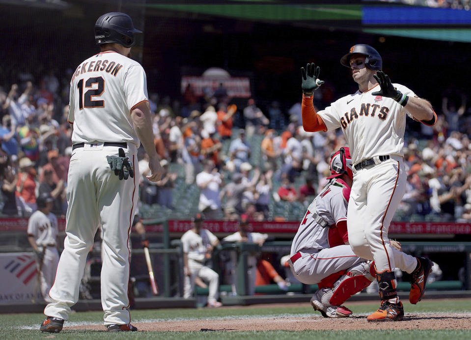 San Francisco Giants' Evan Longoria, right, is congratulated by teammate Alex Dickerson, left, after hitting a two run home run against Los Angeles Angels during the fourth inning of a baseball game Monday, May 31, 2021, in San Francisco. (AP Photo/Tony Avelar)