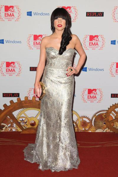 Carly Rae Jepsen: Her dress is lovely but her tangled hair overpowers the rest of her look. The heavy bangs make it hard to see her pretty features and the hair looks lumpy. The printed silver gown looks gorgeous on her however. (Photo by Mike Marsland/Wireimage)