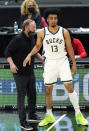 Milwaukee Bucks head coach Mike Budenholzer, left, talks with forward Jordan Nwora during the first half of an NBA basketball game against the Chicago Bulls in Chicago, Friday, April 30, 2021. (AP Photo/Nam Y. Huh)