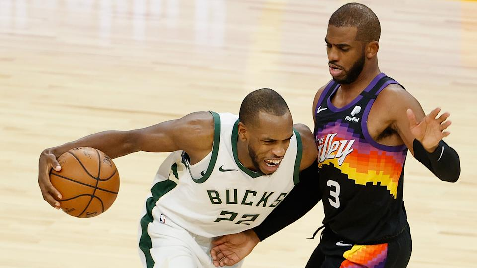 Khris Middleton #22 of the Milwaukee Bucks drives the ball against Chris Paul #3 of the Phoenix Suns. (Photo by Christian Petersen/Getty Images)