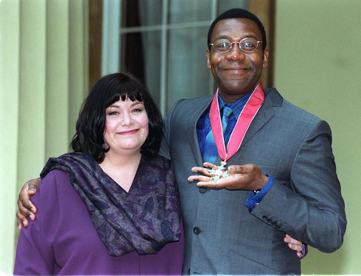 Comedian Lenny Henry and wife Dawn French, also a comedian, pose at Buckingham Palace in London after Lenny was presented with a CBE (Commander of the British Empire) from the Queen. 24/5/99: N/paper report that Henry met blonde woman at hotel. (Photo by Fiona Hanson - PA Images/PA Images via Getty Images)