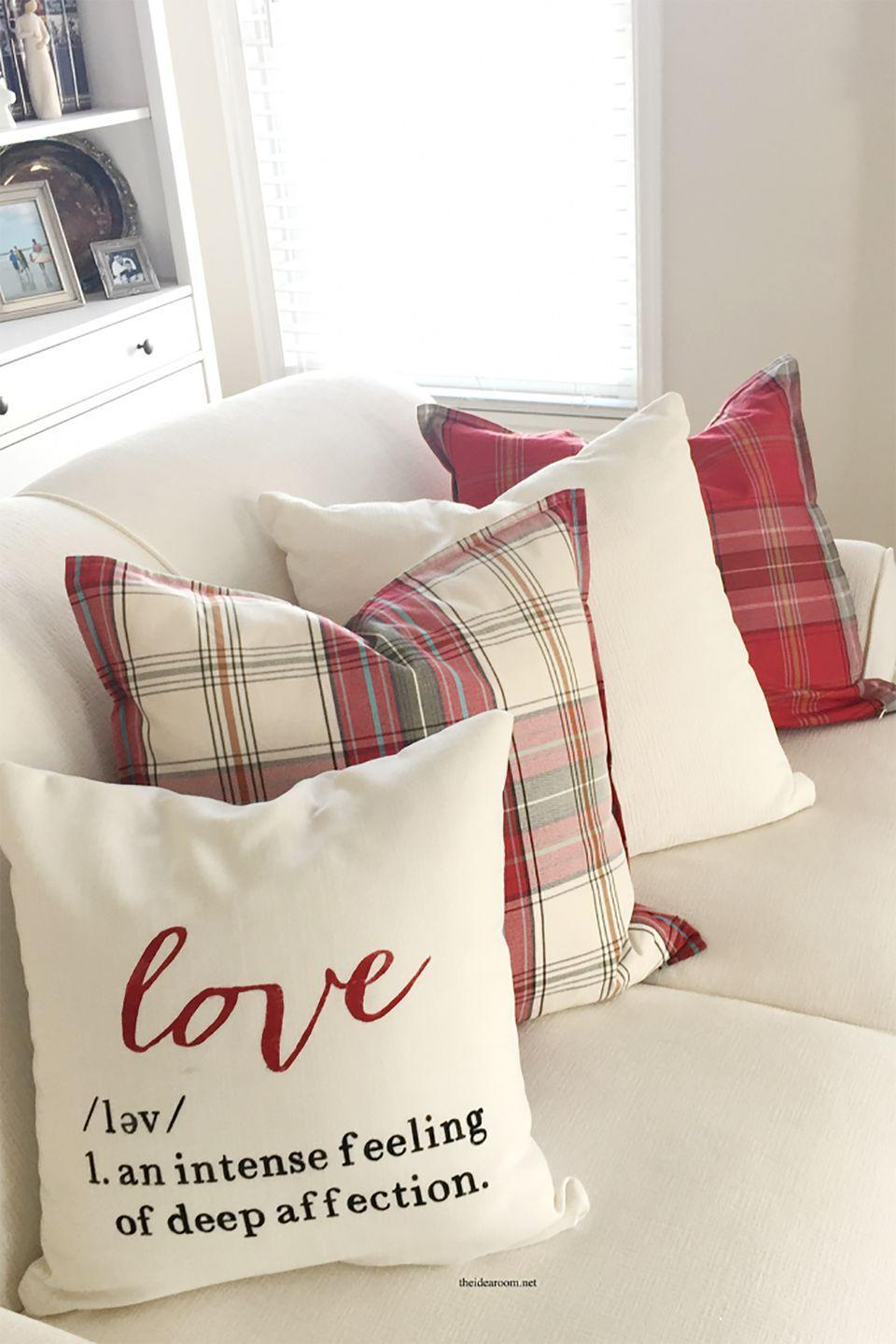 """<p>Pair this handmade love pillow with red and plaid ones for a festive Valentine's couch. </p><p><strong>Get the tutorial at <a href=""""https://www.theidearoom.net/valentines-day-pillow"""" rel=""""nofollow noopener"""" target=""""_blank"""" data-ylk=""""slk:The Idea Room"""" class=""""link rapid-noclick-resp"""">The Idea Room</a>.</strong></p><p><strong><a class=""""link rapid-noclick-resp"""" href=""""https://www.amazon.com/Cricut-2002026-Vinyl-Midnight/dp/B00BV50AN0?tag=syn-yahoo-20&ascsubtag=%5Bartid%7C10050.g.2971%5Bsrc%7Cyahoo-us"""" rel=""""nofollow noopener"""" target=""""_blank"""" data-ylk=""""slk:SHOP CRICUT VINYL"""">SHOP CRICUT VINYL</a><br></strong></p>"""