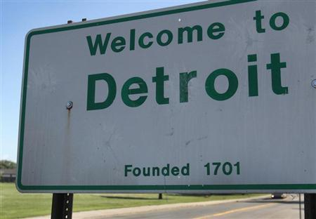 A 'Welcome to Detroit' border sign is seen as traffic enters Detroit