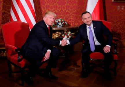 FILE PHOTO: U.S. President Donald Trump is greeted by Polish President Andrzej Duda as he visits Poland during the Three Seas Initiative Summit in Warsaw, Poland July 6, 2017. REUTERS/Carlos Barria