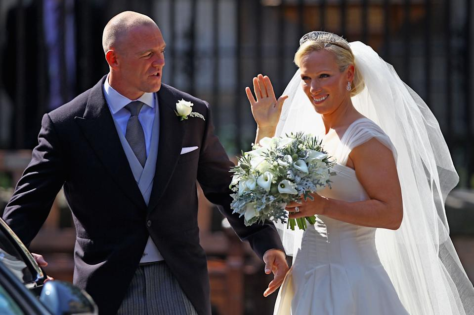 Zara Phillips waves to fans at her wedding to Mike Tindall at Canongate Kirk on July 30, 2011 in Edinburgh, Scotland. The Queen's granddaughter Zara Phillips will marry England rugby player Mike Tindall today at Canongate Kirk.