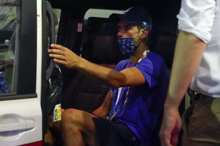 Novak Djokovic, of Serbia, departs the Ariake Tennis Center after his loss to Pablo Carreno Busta, of Spain, in the bronze medal match of the men's singles tennis competition at the 2020 Summer Olympics, Saturday, July 31, 2021, in Tokyo, Japan. (AP Photo/Patrick Semansky)