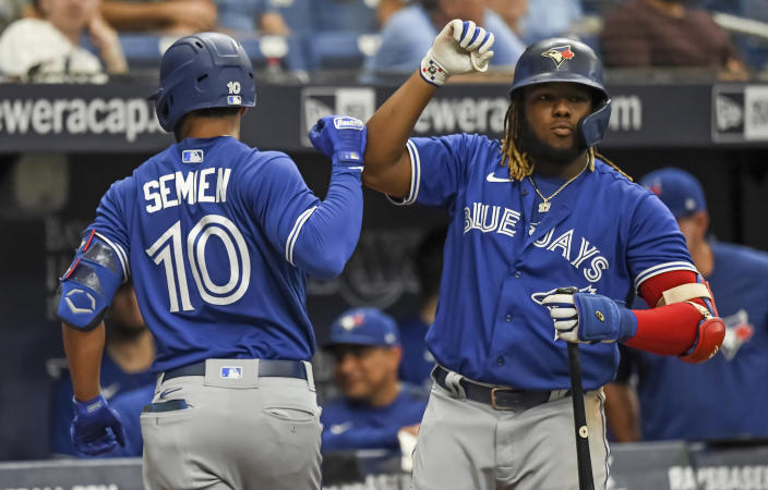 Toronto Blue Jays' Vladimir Guerrero Jr. congratulates Marcus Semien after Semien's two-run home run off Tampa Bay Rays starter Ryan Yarbrough during the third inning of a baseball game Saturday, July 10, 2021, in St. Petersburg, Fla. (AP Photo/Steve Nesius)