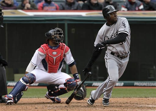 Chicago White Sox's Alejandro De Aza watches the flight of his two-run home run in the sixth inning off Cleveland Indians relief pitcher Dan Wheeler in a baseball game in Cleveland on Wednesday, April 11, 2012. Also watching is Cleveland Indians catcher Carlos Santana. (AP Photo/Amy Sancetta)