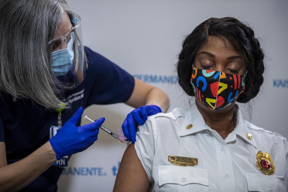 The FDA says there is no evidence linking the COVID-19 to Bell's palsy. Here, an EMS worker gets the COVID-19 vaccine in Washington D.C. on Thursday. (Photo by Shawn Thew-Pool/Getty Images)