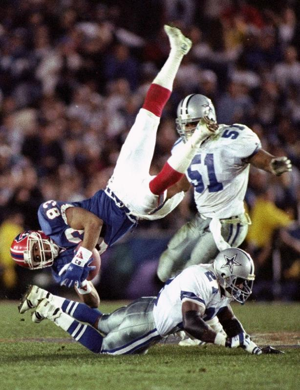 FILE - In this Jan. 31, 1993 file photo, Buffalo Bills' wide receiver Andre Reed is upended by Dallas Cowboys' strong safety Thomas Everett after a 13-yard reception in the third quarter of the Super Bowl in Pasadena, Calif. Reed was elected to the Pro Football Hall of Fame on Saturday, Feb. 1, 2014. (AP Photo/Doug Mills, File)