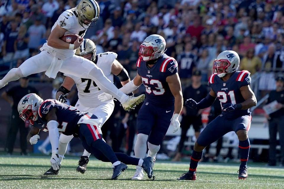 New Orleans Saints quarterback Taysom Hill hurdles New England Patriots free safety Devin McCourty during the second half of their game Sunday in Foxborough, Mass.