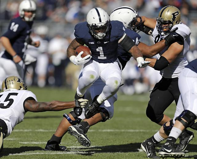 Penn State running back Bill Belton (1) avoids being tackled by Purdue linebacker Will Lucas, left, during the first quarter of an NCAA college football game in State College, Pa., Saturday, Nov. 16, 2013. (AP Photo/Gene J Puskar)