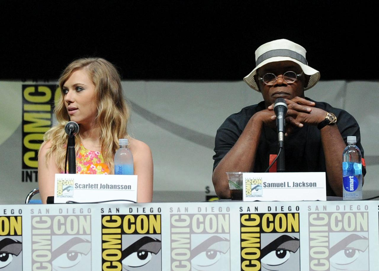 "SAN DIEGO, CA - JULY 20: Actors Scarlett Johansson (L) and Samuel L. Jackson speak onstage at Marvel Studios ""Thor: The Dark World"" and ""Captain America: The Winter Soldier"" during Comic-Con International 2013 at San Diego Convention Center on July 20, 2013 in San Diego, California. (Photo by Kevin Winter/Getty Images)"
