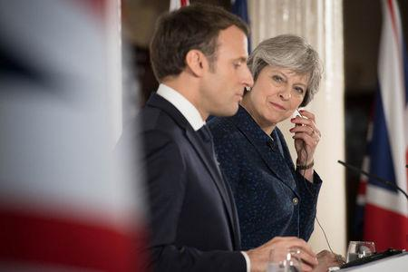 Britain's Prime Minister Theresa May and France's President Emmanuel Macron hold a news conference at the Royal Military Academy in Sandhurst
