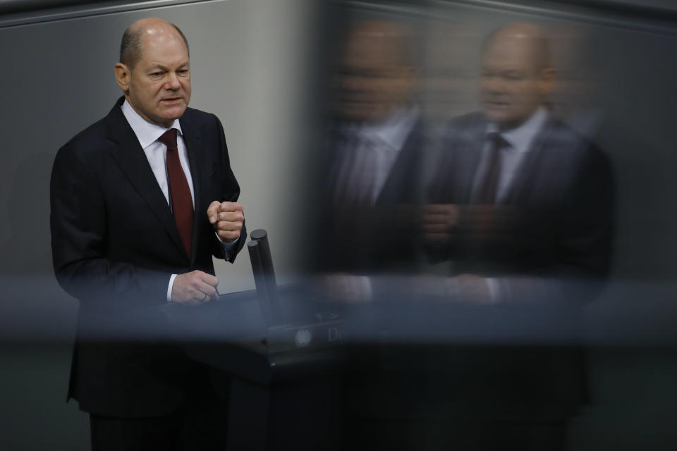 File - In this Tuesday, Dec. 8, 2020 file photo, German Finance Minister Olaf Scholz delivers his speech during the debate about Germany's budget 2021, at the parliament Bundestag in Berlin, Germany. Germany's election campaign has largely focused on the three candidates hoping to succeed Angela Merkel as chancellor after four terms in office, Annalena Baerbock for the Greens, Armin Laschet for the Christian Union parties and Olaf Scholz for the Social Democrats. German elections will be on Sept.26.(AP Photo/Markus Schreiber, File)
