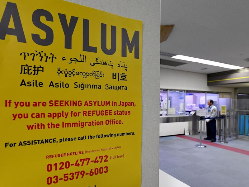 An asylum poster at a Japanese airport: AFP/Getty
